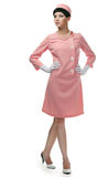 Retro woman in pink dress 60s. Over white background royalty free stock photography