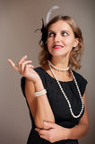 Retro woman pointing upwards Stock Image