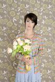Retro woman portrait 60s fashion vintage. Flowers wallpaper royalty free stock image