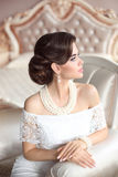Retro woman portrait. Elegant brunette lady with fashion pearls Stock Photo