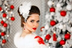 Free Retro Woman Portrait In Fur Coat. Elegant Brunette Woman With Feather In Wedding Hairstyle, Beauty Makeup And Ruby Jewelry Set Stock Photography - 203797112