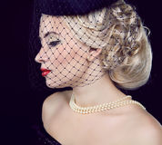 Retro woman portrait. Jewelry and Beauty. Royalty Free Stock Images