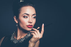 Retro woman portrait, standing on the black background Royalty Free Stock Images