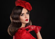 Retro Woman Portrait. Vintage Style Girl Wearing red fashion Hat Stock Photos