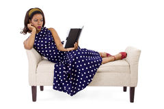 Retro Woman Reading a Book Stock Image