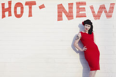 Retro Woman In Red Dress Against Brick Wall Royalty Free Stock Photos