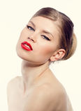 Retro woman with red lips. Charming fashionable retro woman portrait. Young blonde model with sexy red lips Royalty Free Stock Photography