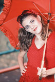 Retro woman in red posing Stock Image