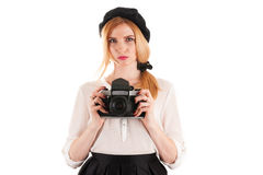 Retro woman with retro camera Royalty Free Stock Images