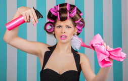 Retro woman in rollers multitasking Stock Photography