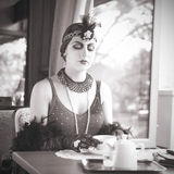 Retro Woman 1920s - 1930s Sitting with Cup of Tea Royalty Free Stock Photo