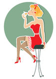 Retro woman is sitting and drinking Stock Photography