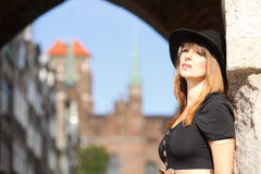 Retro woman on street of old town Gdansk Royalty Free Stock Photography