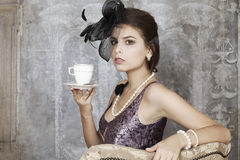 Retro woman with tea Royalty Free Stock Images
