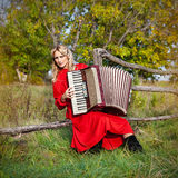 Retro woman in traditional costume with an accordion Stock Photo