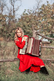 Retro woman in traditional costume with an accordion Stock Photos