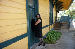 Retro Woman at Train Depot Stock Image