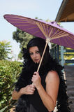 Retro Woman at Train Depot Holding Umbrella Stock Photography