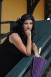 Retro Woman at Train Depot Holding Umbrella Royalty Free Stock Images