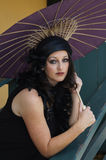 Retro Woman at Train Depot Holding Umbrella Stock Photography