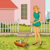 Retro woman trimming lawn in garden Stock Photo