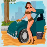 Retro woman washing car Royalty Free Stock Image