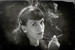 Retro women with cigarette Stock Image