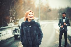 Retro woman in coat on road. Couple in love on romantic date. Bearded man and sexy woman in fur coat. Escort of girl by. Retro women in coat on road. Couple in stock photos