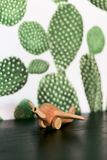 Retro wood toy airplane on table with cactus background royalty free stock images