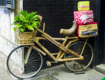Retro wooden bike with gifts and a basket of flowers Royalty Free Stock Images