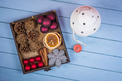 Retro wooden box with Christmas decorations and lantern Stock Photo