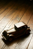 Retro wooden car model. On parquet floor old ambiance light stock photo