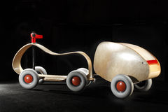 Retro wooden car toy. Closeup of retro wooden car toy with black background Stock Photo