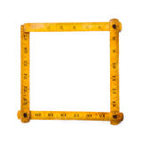 Retro wooden carpenter ruler measure. measuring tools. square shape. on white background. copy space Royalty Free Stock Image