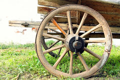 Retro wooden cart wheel taken closeup. Stock Images