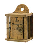 Retro wooden clock box mechanism residue isolated. Retro wooden clock box and mechanism gear wheel residue isolated on white Stock Image
