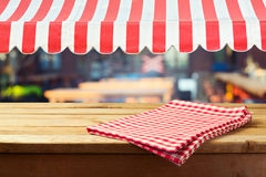Retro wooden counter with tablecloth and awing for product montage display Royalty Free Stock Photo