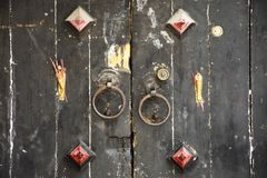 Retro wooden door and antique lock door chinese old style with joss stick at house in Chaozhou at Teochew in Guangdong, China stock images