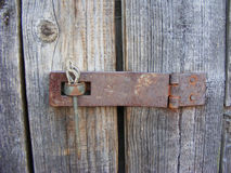 Retro wooden door with rusty lock. Retro wooden door with old rusty lock Stock Image
