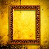Retro wooden frame over gold grunge wallpaper Royalty Free Stock Image