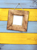 Wooden frame on wooden wall Stock Photos