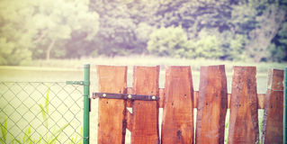 Retro wooden garden gate and wire fence Stock Image