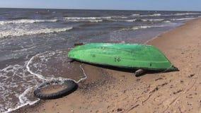 Retro wooden green boat on empty sea resort beach Stock Photos