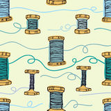 Retro wooden reels of thread. Threads in blue colo Stock Photo
