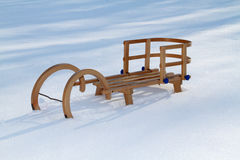 Retro wooden sledge in snow Royalty Free Stock Photo