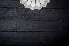 Retro wooden table with doily Stock Image