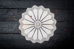 Retro wooden table with doily Royalty Free Stock Images