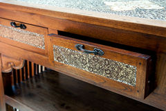 Retro wooden table with opened drawer Royalty Free Stock Image