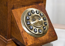 Retro wooden telephone. Circle dialer royalty free stock images