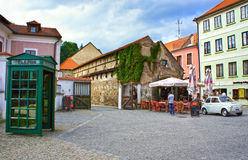 Retro wooden telephone box on the old streets of Cesky Krumlov Stock Photos